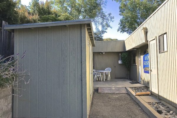 Our rear entrance features an outdoor seating area and a food shed where we stock prescription diets.